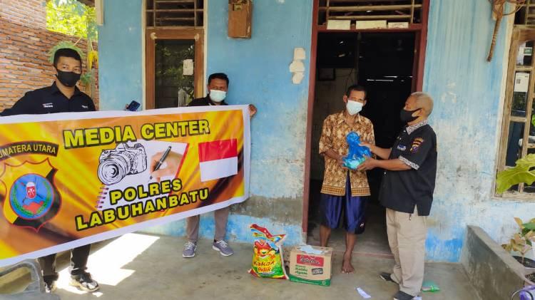 Kolaborasi, Media Center Polres Labuhanbatu Bersama Biro Nusantara Netizen Salurkan Bahan Pangan